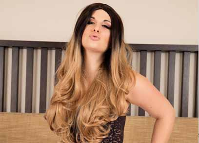Tgirl Bailey Jay posing in Black Lingerie