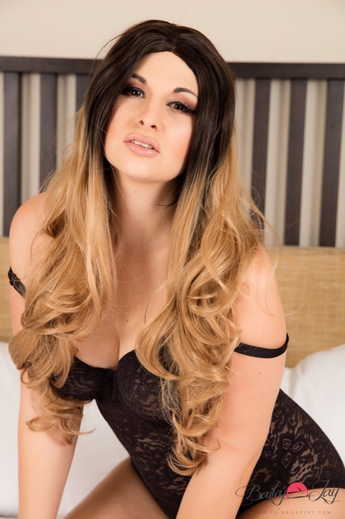 Tgirl Bailey Jay posing in black lace lingerie on her bed